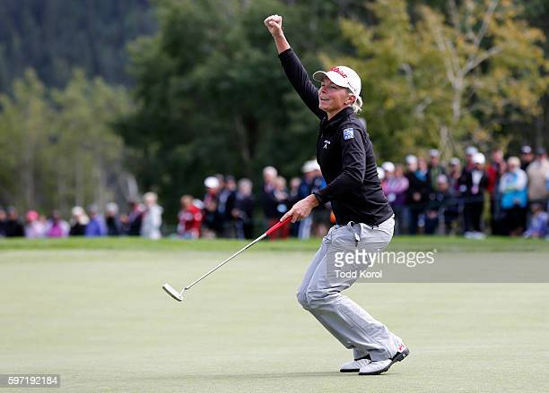 Alena Sharp of Canada reacts to her putt on the 18th hole during the final round of the Canadian Pacific Women's Open at Priddis Greens Golf and...