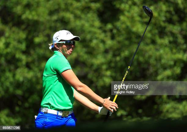 Alena Sharp of Canada watches her tee shot on the 18th hole during the first round of the Manulife LPGA Classic at Whistle Bear Golf Club on June 08...