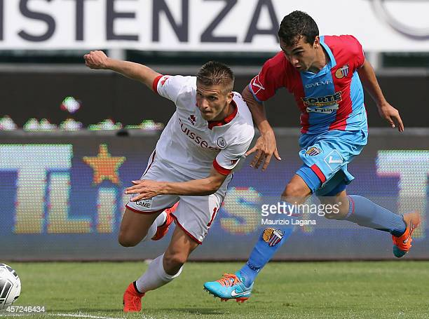Alena Stevanovic of AS Bari competes for the ball with Sergio Garufo of catania during the Serie B match between Catania Calcio and AS Bari at Stadio...