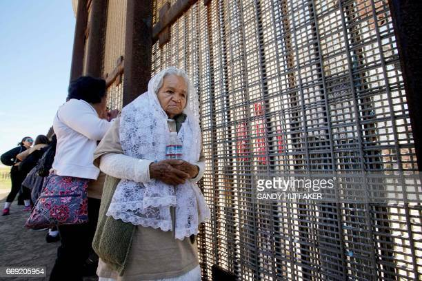 Alendra Valles speaks with people on the Mexico side during a binational Easter mass along the USMexico border fence at Friendship Park in San Ysidro...
