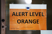 Alert Level Orange sign is seen on an EU Commission building following todays attack on March 22 2016 in Brussels Belgium At least 31 people are...