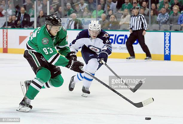 Ales Hemsky of the Dallas Stars controls the puck against Jacob Trouba of the Winnipeg Jets in the first period at American Airlines Center on...