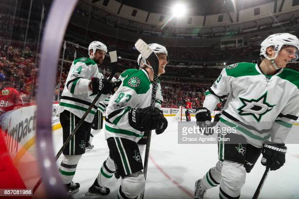 Ales Hemsky of the Dallas Stars reacts in between Jamie Benn and John Klingberg after scoring and tying the game in the third period against the...