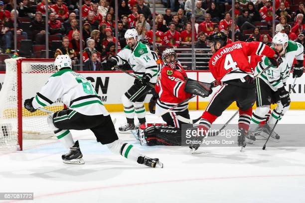 Ales Hemsky of the Dallas Stars scores on goalie Corey Crawford of the Chicago Blackhawks to tie the game in the third period at the United Center on...