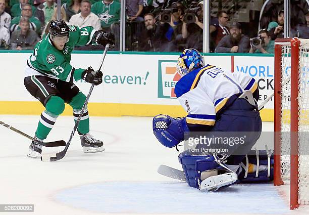 Ales Hemsky of the Dallas Stars shoot the puck against Brian Elliott of the St Louis Blues in the first period in Game One of the Western Conference...