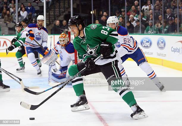 Ales Hemsky of the Dallas Stars skates the puck against Eric Gryba of the Edmonton Oilers in the first period at American Airlines Center on January...