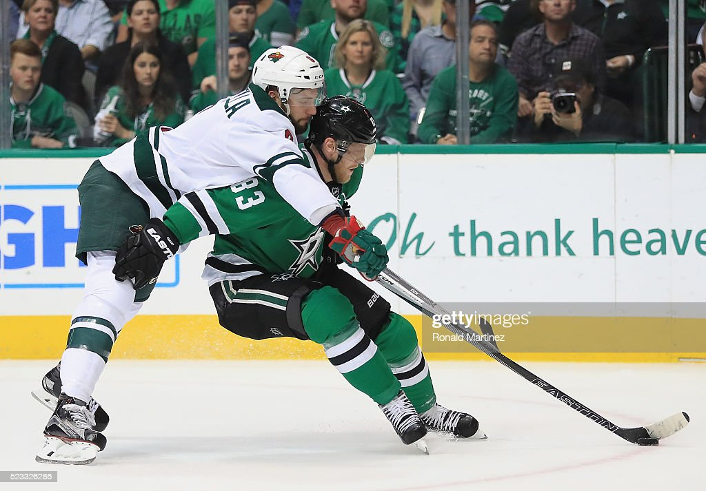 <a gi-track='captionPersonalityLinkClicked' href=/galleries/search?phrase=Ales+Hemsky&family=editorial&specificpeople=202828 ng-click='$event.stopPropagation()'>Ales Hemsky</a> #83 of the Dallas Stars skates the puck against <a gi-track='captionPersonalityLinkClicked' href=/galleries/search?phrase=Marco+Scandella&family=editorial&specificpeople=5408903 ng-click='$event.stopPropagation()'>Marco Scandella</a> #6 of the Minnesota Wild in the first period in Game Five of the Western Conference First Round during the 2016 NHL Stanley Cup Playoffs at American Airlines Center on April 22, 2016 in Dallas, Texas.