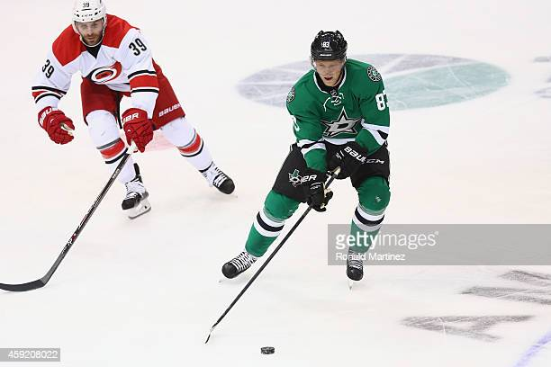 Ales Hemsky of the Dallas Stars skates the puck against Patrick Dwyer of the Carolina Hurricanes in the third period at American Airlines Center on...