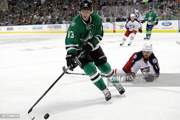 Ales Hemsky of the Dallas Stars skates the puck past Brandon Dubinsky of the Columbus Blue Jackets in the first period at American Airlines Center on...