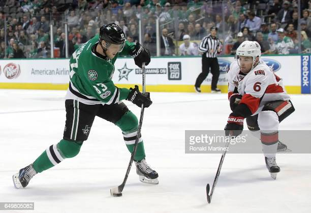 Ales Hemsky of the Dallas Stars takes a shot in front of Chris Wideman of the Ottawa Senators in the first period at American Airlines Center on...