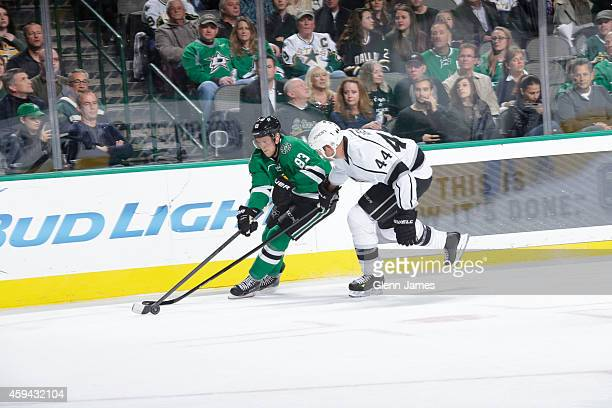 Ales Hemsky of the Dallas Stars tries to keep the puck away against Robyn Regehr of the Los Angeles Kings at the American Airlines Center on November...