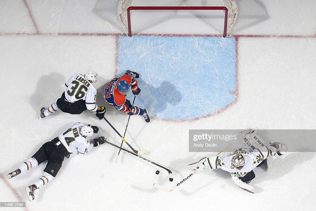 <a gi-track='captionPersonalityLinkClicked' href=/galleries/search?phrase=Ales+Hemsky&family=editorial&specificpeople=202828 ng-click='$event.stopPropagation()'>Ales Hemsky</a> #83 of the Edmonton Oilers and <a gi-track='captionPersonalityLinkClicked' href=/galleries/search?phrase=Kari+Lehtonen&family=editorial&specificpeople=211612 ng-click='$event.stopPropagation()'>Kari Lehtonen</a> #32 of the Dallas Stars reach for the loose puck at Rexall Place on March 2, 2012 in Edmonton, Alberta, Canada.