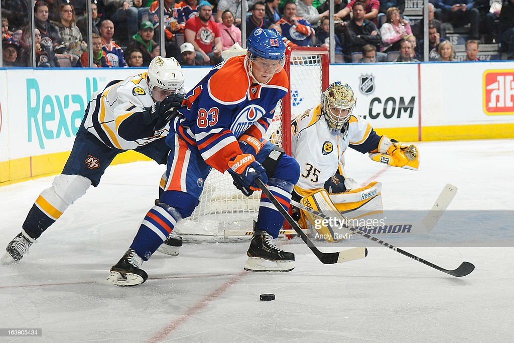 <a gi-track='captionPersonalityLinkClicked' href=/galleries/search?phrase=Ales+Hemsky&family=editorial&specificpeople=202828 ng-click='$event.stopPropagation()'>Ales Hemsky</a> #83 of the Edmonton Oilers battles for position against <a gi-track='captionPersonalityLinkClicked' href=/galleries/search?phrase=Jonathon+Blum&family=editorial&specificpeople=4306183 ng-click='$event.stopPropagation()'>Jonathon Blum</a> #7 of the Nashville Predators on March 17, 2013 at Rexall Place in Edmonton, Alberta, Canada.