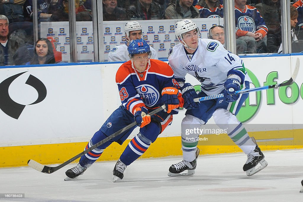 <a gi-track='captionPersonalityLinkClicked' href=/galleries/search?phrase=Ales+Hemsky&family=editorial&specificpeople=202828 ng-click='$event.stopPropagation()'>Ales Hemsky</a> #83 of the Edmonton Oilers battles for position in an NHL game against Alex Burrows #14 of the Vancouver Canucks on February 4, 2013 at Rexall Place in Edmonton, Alberta, Canada.