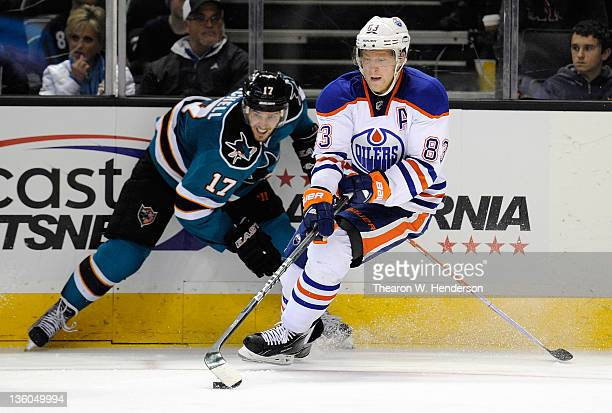 Ales Hemsky of the Edmonton Oilers gains control of the puck in front of Torrey Mitchell of the San Jose Sharks at HP Pavilion at San Jose on...