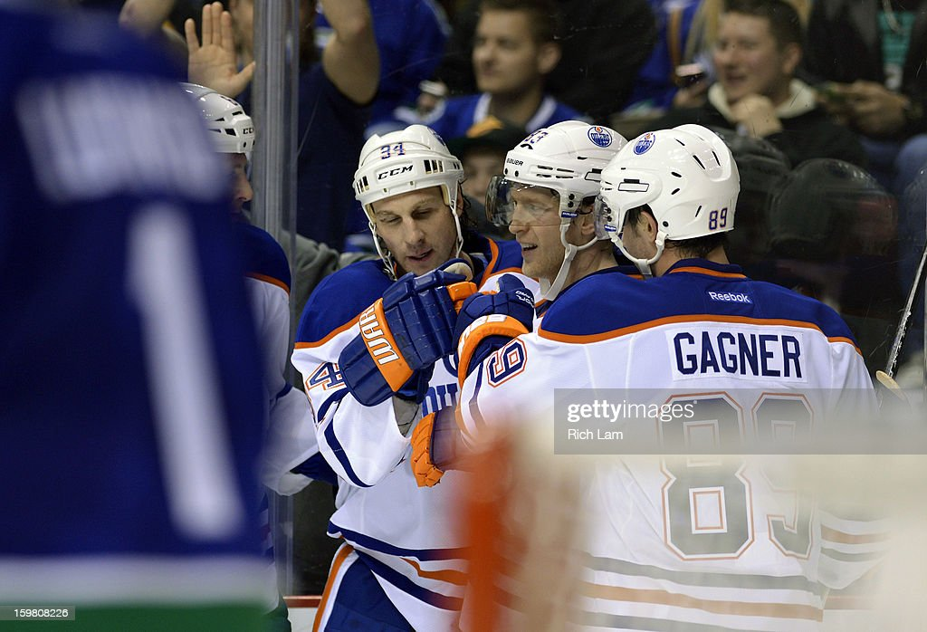 Ales Hemsky #83 of the Edmonton Oilers is congratulated by Ryan Smyth #94 and Sam Gagner #89 after scoring the game tying goal against goalie Roberto Luongo #1 of the Vancouver Canucks during the third period of NHL action on January 20, 2013 at Rogers Arena in Vancouver, British Columbia, Canada.