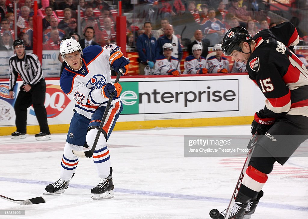<a gi-track='captionPersonalityLinkClicked' href=/galleries/search?phrase=Ales+Hemsky&family=editorial&specificpeople=202828 ng-click='$event.stopPropagation()'>Ales Hemsky</a> #83 of the Edmonton Oilers saucers the puck past Zack Smith #15 of the Ottawa Senators during an NHL game at Canadian Tire Centre on October 19, 2012 in Ottawa, Ontario, Canada.