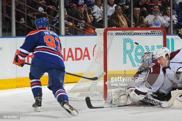Ales Hemsky of the Edmonton Oilers scores a goal on Semyon Varlamov of the Colorado Avalanche on February 16 2013 at Rexall Place in Edmonton Alberta...