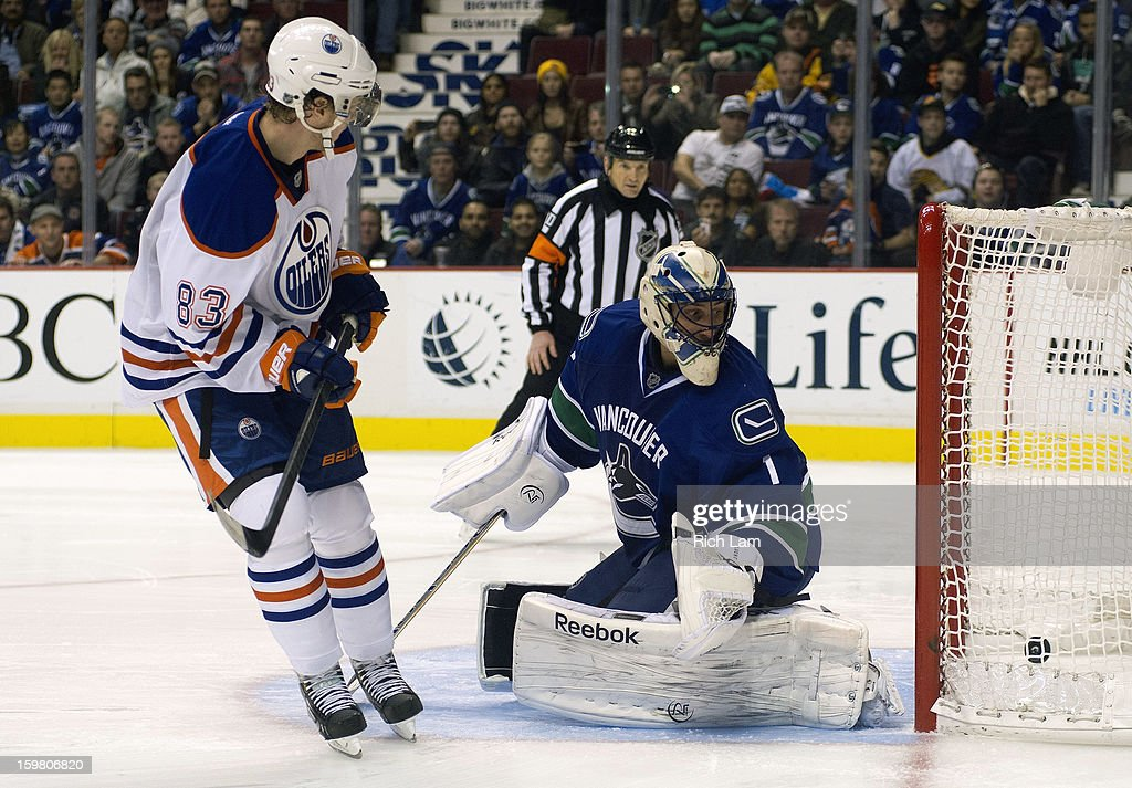 <a gi-track='captionPersonalityLinkClicked' href=/galleries/search?phrase=Ales+Hemsky&family=editorial&specificpeople=202828 ng-click='$event.stopPropagation()'>Ales Hemsky</a> #83 of the Edmonton Oilers scores on goalie <a gi-track='captionPersonalityLinkClicked' href=/galleries/search?phrase=Roberto+Luongo&family=editorial&specificpeople=202638 ng-click='$event.stopPropagation()'>Roberto Luongo</a> #1 of the Vancouver Canucks to end the game during the shootout in NHL action on January 20, 2013 at Rogers Arena in Vancouver, British Columbia, Canada. The Oilers defeated the Canucks 3-2