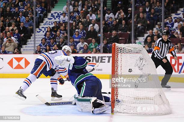 Ales Hemsky of the Edmonton Oilers scores the shootout tying goal on Roberto Luongo of the Vancouver Canucks in NHL action on January 24 2012 at...