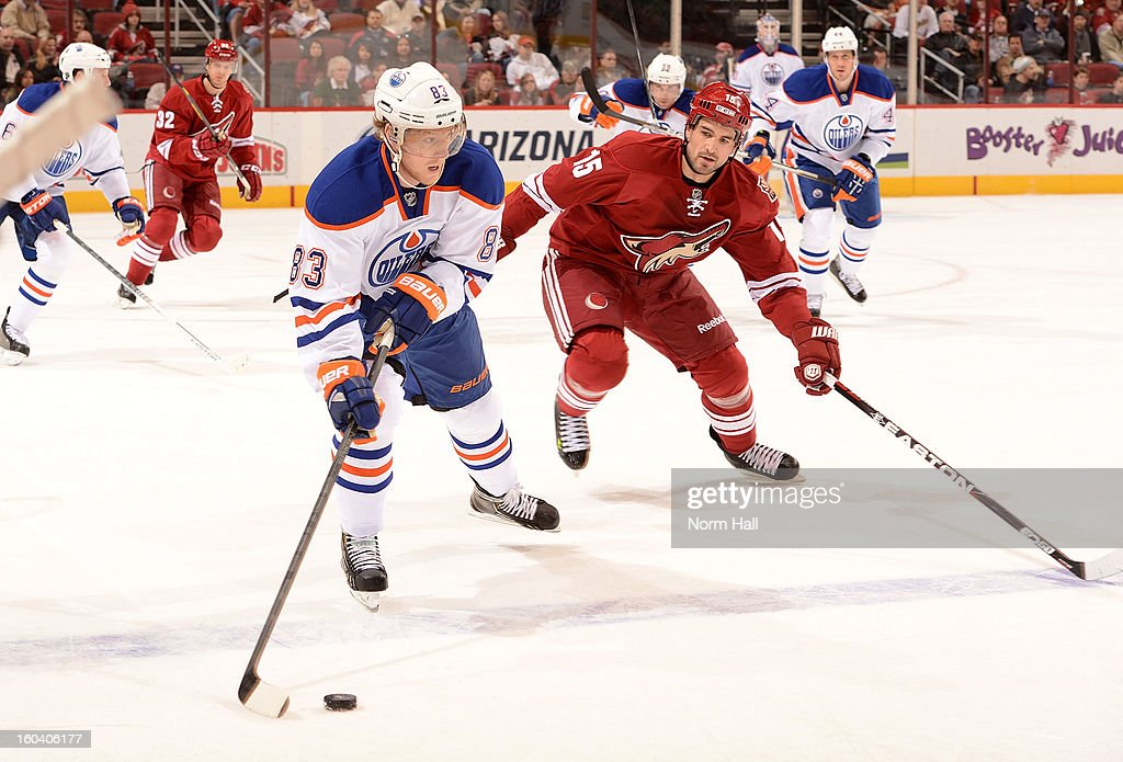 <a gi-track='captionPersonalityLinkClicked' href=/galleries/search?phrase=Ales+Hemsky&family=editorial&specificpeople=202828 ng-click='$event.stopPropagation()'>Ales Hemsky</a> #83 of the Edmonton Oilers skates the puck up ice while being chased by <a gi-track='captionPersonalityLinkClicked' href=/galleries/search?phrase=Boyd+Gordon&family=editorial&specificpeople=209395 ng-click='$event.stopPropagation()'>Boyd Gordon</a> #15 of the Phoenix Coyotes at Jobing.com Arena on January 30, 2013 in Glendale, Arizona.