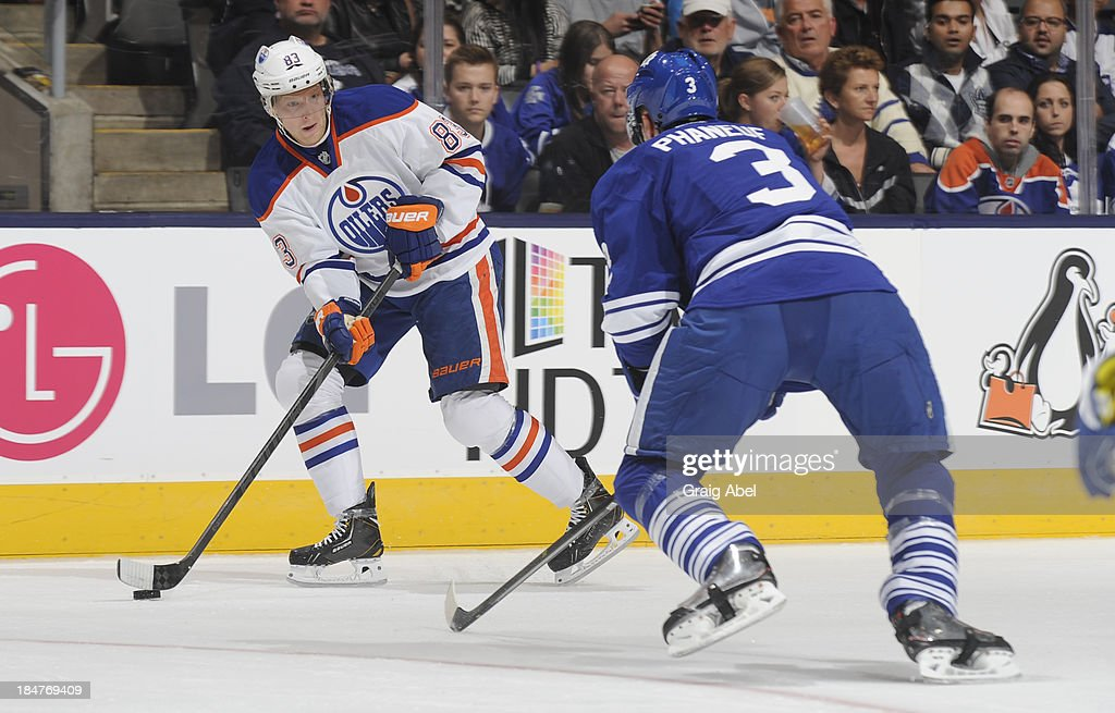 <a gi-track='captionPersonalityLinkClicked' href=/galleries/search?phrase=Ales+Hemsky&family=editorial&specificpeople=202828 ng-click='$event.stopPropagation()'>Ales Hemsky</a> #83 of the Edmonton Oilers skates with the puck as <a gi-track='captionPersonalityLinkClicked' href=/galleries/search?phrase=Dion+Phaneuf&family=editorial&specificpeople=545455 ng-click='$event.stopPropagation()'>Dion Phaneuf</a> #3 of the Toronto Maple Leafs defends during NHL game action October 12, 2013 at Air Canada Centre in Toronto, Ontario, Canada.