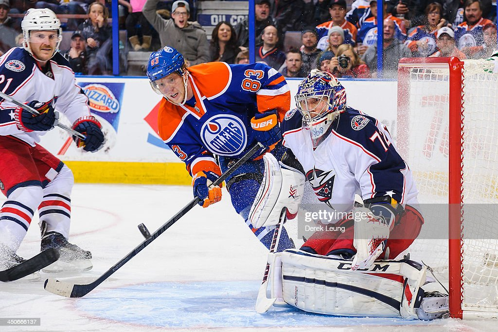 <a gi-track='captionPersonalityLinkClicked' href=/galleries/search?phrase=Ales+Hemsky&family=editorial&specificpeople=202828 ng-click='$event.stopPropagation()'>Ales Hemsky</a> #83 of the Edmonton Oilers tries to deflect the puck into the net against <a gi-track='captionPersonalityLinkClicked' href=/galleries/search?phrase=Sergei+Bobrovsky&family=editorial&specificpeople=4488556 ng-click='$event.stopPropagation()'>Sergei Bobrovsky</a> #72 of the Columbus Blue Jackets during an NHL game at Rexall Place on November 19, 2013 in Edmonton, Alberta, Canada.