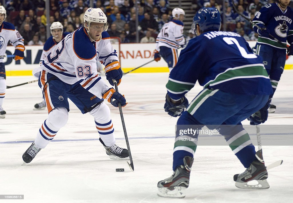 <a gi-track='captionPersonalityLinkClicked' href=/galleries/search?phrase=Ales+Hemsky&family=editorial&specificpeople=202828 ng-click='$event.stopPropagation()'>Ales Hemsky</a> #83 of the Edmonton Oilers tries to get past <a gi-track='captionPersonalityLinkClicked' href=/galleries/search?phrase=Dan+Hamhuis&family=editorial&specificpeople=204213 ng-click='$event.stopPropagation()'>Dan Hamhuis</a> #2 of the Vancouver Canucks during the third period of NHL action on January 20, 2013 at Rogers Arena in Vancouver, British Columbia, Canada.