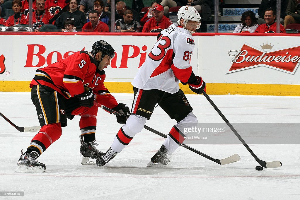 <a gi-track='captionPersonalityLinkClicked' href=/galleries/search?phrase=Ales+Hemsky&family=editorial&specificpeople=202828 ng-click='$event.stopPropagation()'>Ales Hemsky</a> #83 the Ottawa Senators skates against <a gi-track='captionPersonalityLinkClicked' href=/galleries/search?phrase=Mark+Giordano&family=editorial&specificpeople=696867 ng-click='$event.stopPropagation()'>Mark Giordano</a> #5 of the Calgary Flames at Scotiabank Saddledome on March 5, 2014 in Calgary, Alberta, Canada.
