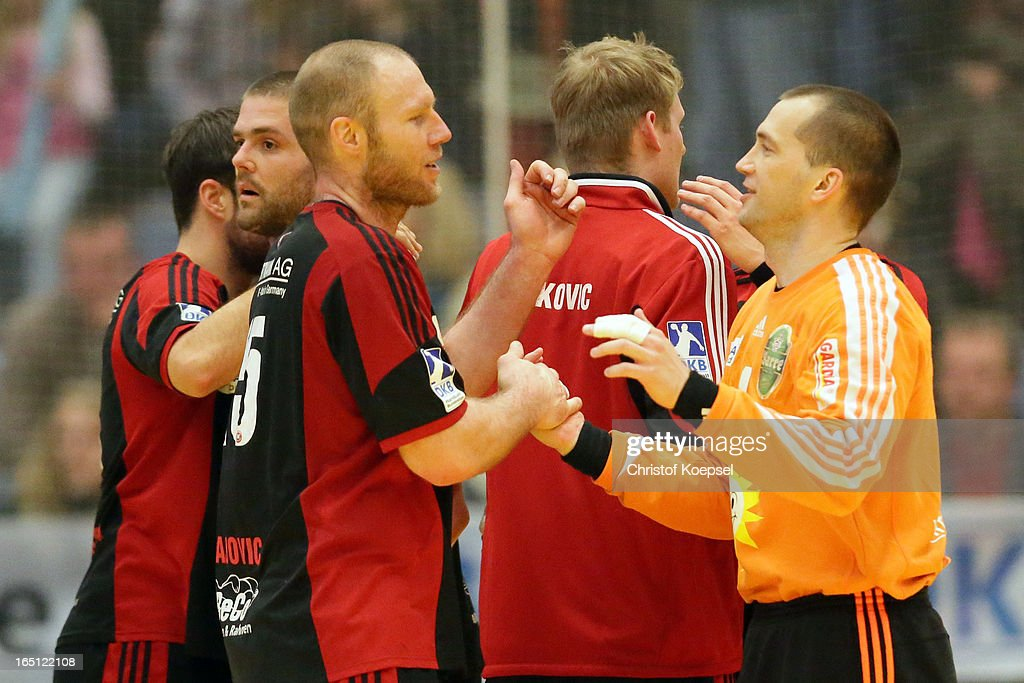 Ales Pajovic and Nikola Blazicko of Tus N-Luebbeck ecelebraste after winning the DKB Handball Bundesliga match between TUSEM Essen and Tus N-Luebbecke at the Sportpark Am Hallo on March 31, 2013 in Essen, Germany. The match between Essen and TuS N-Luebbecke ended 30-36.