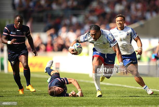 Alesana Tuilagi of Samoa evades a tackle by Chris Wyles of the United States during the 2015 Rugby World Cup Pool B match between Samoa and USA at...