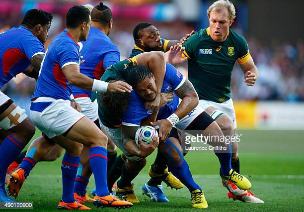 Alesana Tuilagi of Samoa is held up by the South Africa defence during the 2015 Rugby World Cup Pool B match between South Africa and Samoa at Villa...