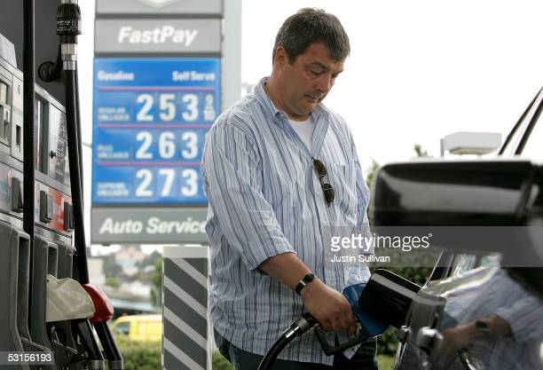 Alesandro Baldo pumps gas into his car at a Chevron service station June 27 2005 in San Franisco California Oil prices reached a record high today...
