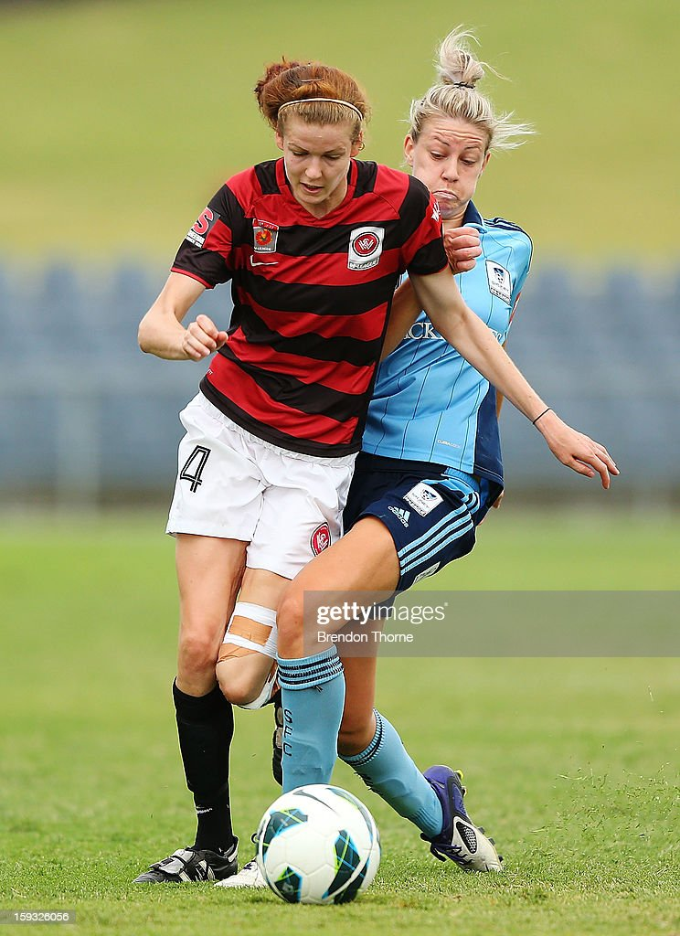 Alesha Clifford of the Wanderers competes with Alanna Kennedy of Sydney during the round 12 W-League match between the Western Sydney Wanderers and Sydney FC at Campbelltown Sports Stadium on January 12, 2013 in Sydney, Australia.