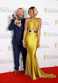 Alesha Dixon and Leigh Francis aka Keith Lemon winner of the Entertainment Performance award for 'Celebrity Juice' pose in the winners room at the...