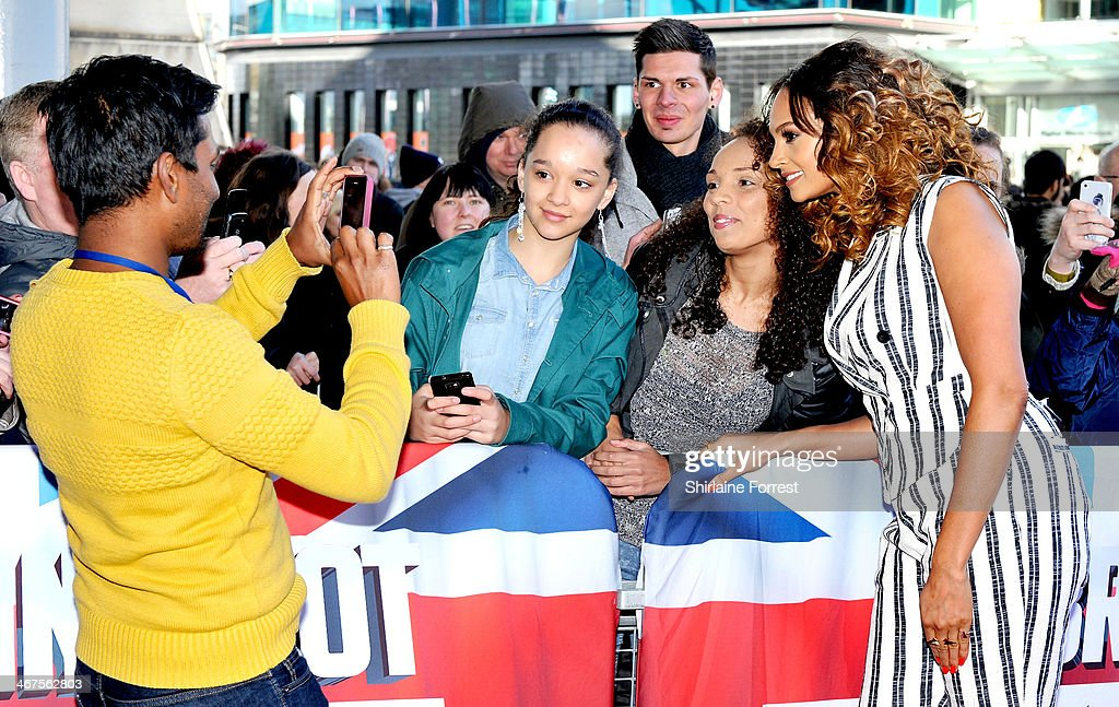 <a gi-track='captionPersonalityLinkClicked' href=/galleries/search?phrase=Alesha+Dixon&family=editorial&specificpeople=220622 ng-click='$event.stopPropagation()'>Alesha Dixon</a> poses for a picture with fans as she attends the Manchester auditions for Britain's Got Talent at The Lowry on February 7, 2014 in Manchester, England.