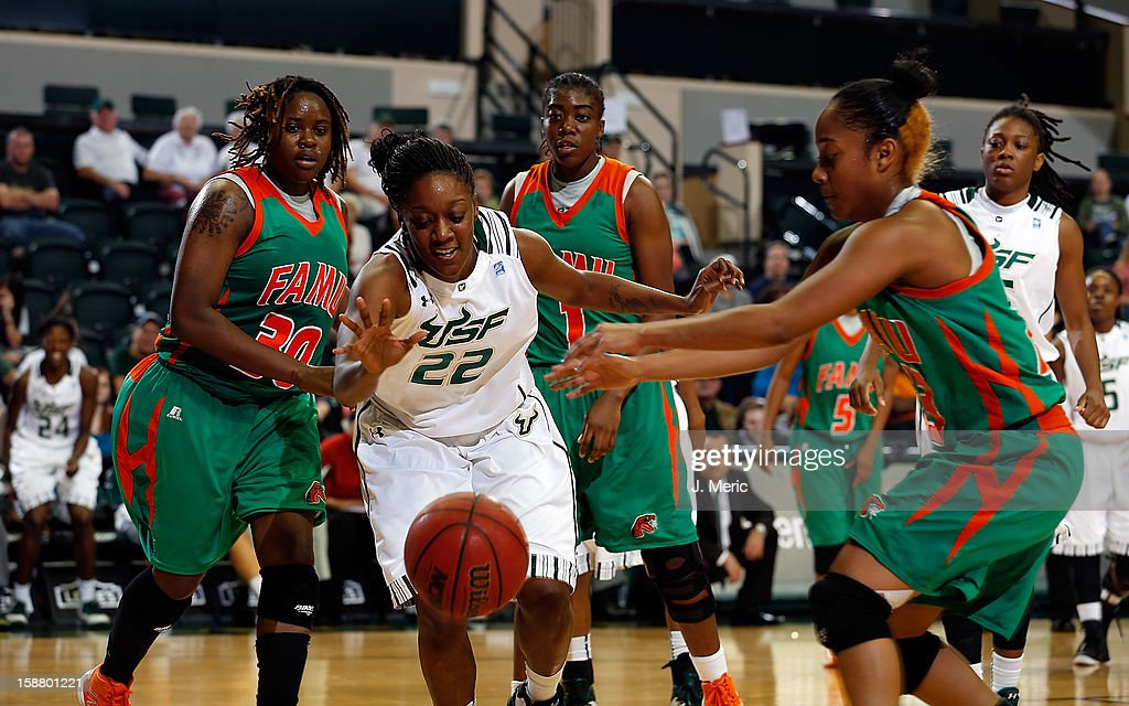 Aleshia Flowers #22 of the South Florida Bulls battles Cristal Liriano #23 of the Florida A&M Rattlers for a rebound as Jamie Foreman #30 and Jaleesa Blue #1 look on during the game at the Sun Dome on December 29, 2012 in Tampa, Florida.