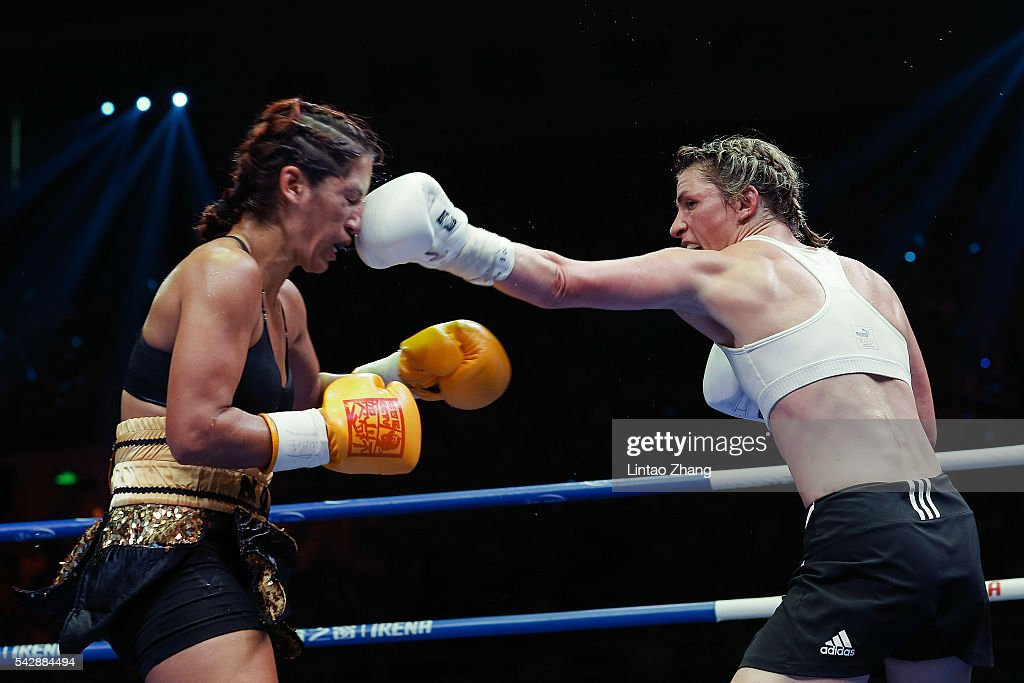 Alesia Graf of Germany delivers a punch to Noemi Bosques of United States during their International Women's WBA featherweight gold belt match at Capital Indoor Stadium on June 24, 2016 in Beijing, China.
