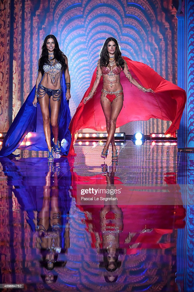 Alessandra Ambrosio and Adriana Lima walk the runway at the annual Victoria's Secret fashion show at Earls Court on December 2, 2014 in London, England.