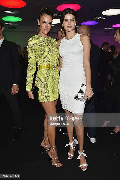 Alessandra Ambrosio and Isabeli Fontana attend amfAR Milano 2015 at La Permanente on September 26 2015 in Milan Italy