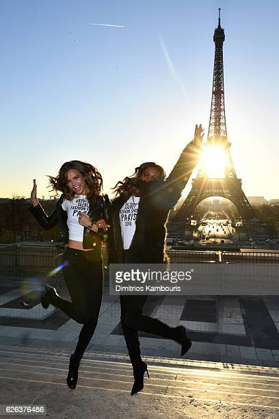 Alessandra Ambrosio and Jasmine Tookes pose in front of the Eiffel Tower prior the 2016 Victoria's Secret Fashion Show on November 29 2016 in Paris...