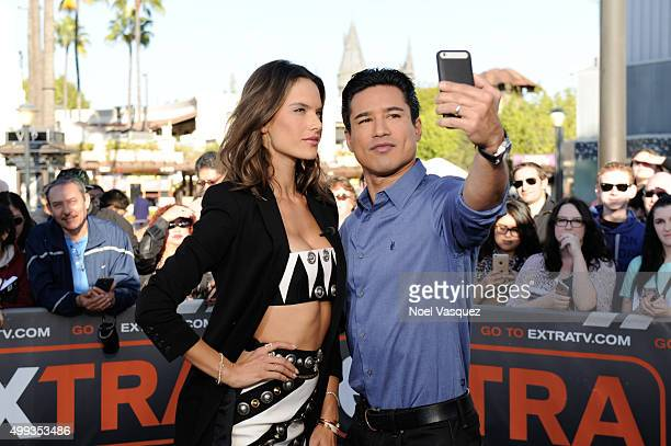Alessandra Ambrosio and Mario Lopez visit 'Extra' at Universal Studios Hollywood on November 30 2015 in Universal City California