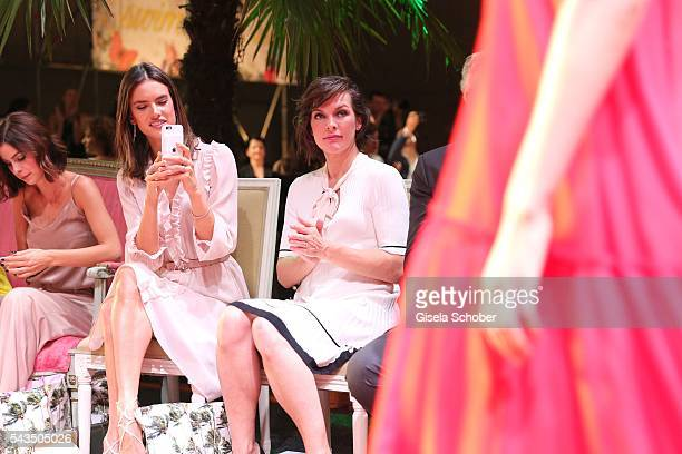 Alessandra Ambrosio and Milla Jovovich during the Marc Cain fashion show spring/summer 2017 at CITY CUBE Panorama Bar on June 28 2016 in Berlin...