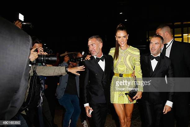 Alessandra Ambrosio Dean Caten and Dan Caten arrive at amfAR Milano 2015 at La Permanente on September 26 2015 in Milan Italy