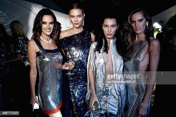 Alessandra Ambrosio Karlie Kloss Bella Hadid and Izabel Goulart prepare backstage at the amfAR's 23rd Cinema Against AIDS Gala at Hotel du CapEdenRoc...