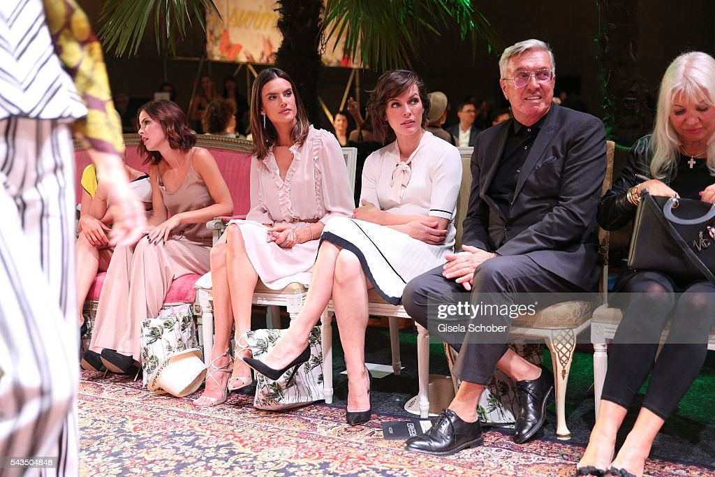 <a gi-track='captionPersonalityLinkClicked' href=/galleries/search?phrase=Alessandra+Ambrosio&family=editorial&specificpeople=203062 ng-click='$event.stopPropagation()'>Alessandra Ambrosio</a>, <a gi-track='captionPersonalityLinkClicked' href=/galleries/search?phrase=Milla+Jovovich&family=editorial&specificpeople=202207 ng-click='$event.stopPropagation()'>Milla Jovovich</a> and Helmut Schlotterer, Founder and CEO of Marc Cain during the Marc Cain fashion show spring/summer 2017 at CITY CUBE Panorama Bar on June 28, 2016 in Berlin, Germany.