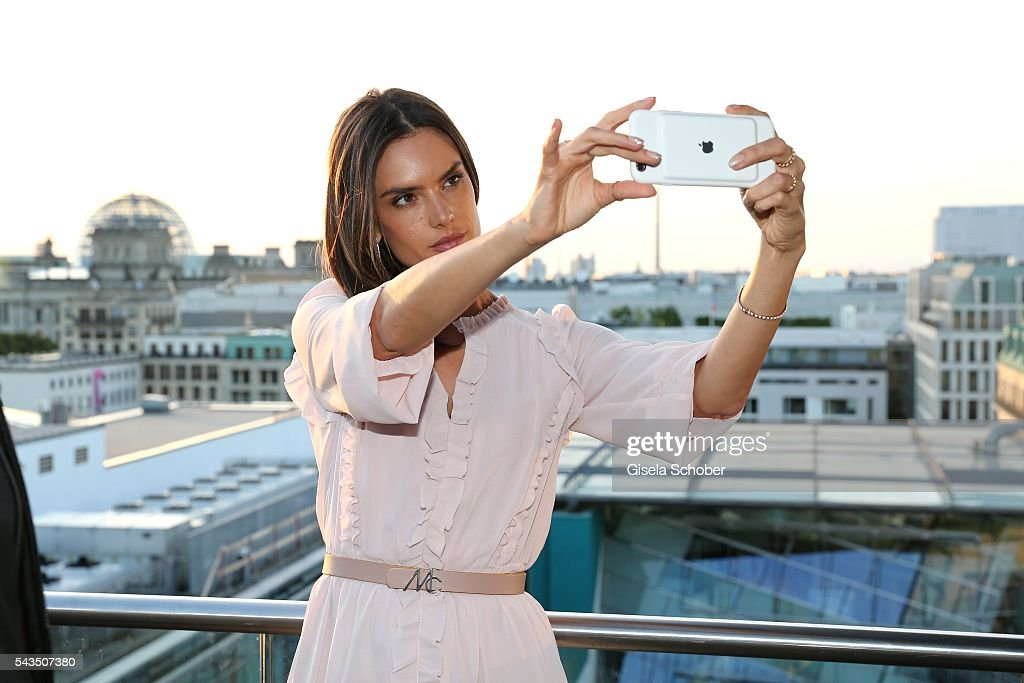 Alessandra Ambrosio taking a selfie during the after party of the Marc Cain fashion show spring/summer 2017 at China Club on June 28, 2016 in Berlin, Germany.