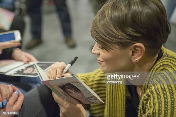 Alessandra Amoroso signs autographs during the presentation of 'Vivere a Colori' on January 29 2016 in Turin Italy