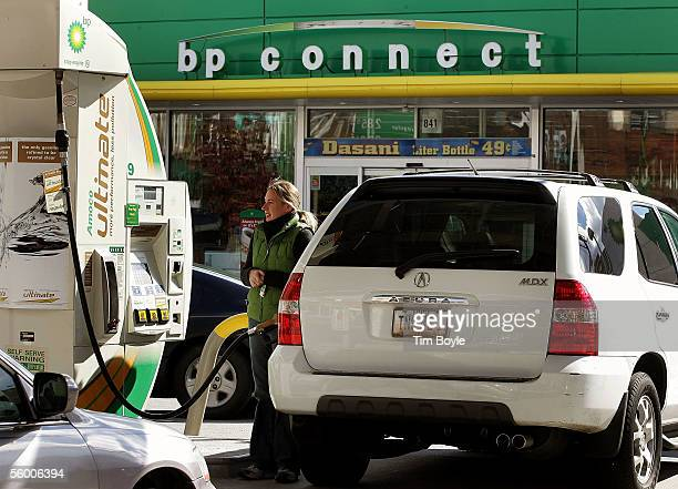 Alessandra Hall pumps gasoline into her sport utility vehicle at a BP Amoco gas station October 25 2005 in Chicago Illinois BP posted a 34 percent...