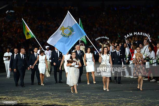 Alessandra Perilli of the San Marino Olympic shooting team carries her country's flag during the Opening Ceremony of the London 2012 Olympic Games at...